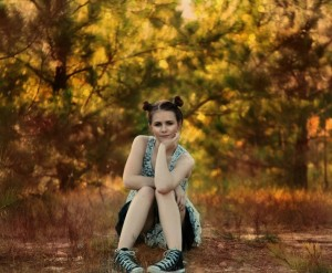 girl-sitting-posing-trees-large