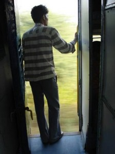 man-on-door-in-indian-railway-130904c